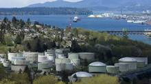 Oil strorage tanks that are part of the Chevron Burnaby Oil Refinery are shown on the shores of Burrard Inlet in this view from Burnaby, B.C. (ANDY CLARK/Andy Clark/Reuters)