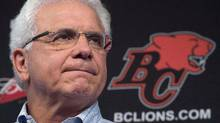 B.C. Lions head general manager Wally Buono pauses for a moment during a news conference at the teams practice facility in Surrey, B.C., on Nov. 17, 2014. (Jonathan Hayward/THE CANADIAN PRESS)