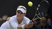 Eugenie Bouchard of Canada hits a return to Andrea Petkovic of Germany during their women's singles tennis match at the Wimbledon Tennis Championships, in London June 28. (TOBY MELVILLE/REUTERS)
