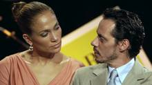 Jennifer Lopez and husband Marc Anthony attend a signing ceremony for new filmmaking incentive legislation for the U.S. island territory in Bayamon, Puerto Rico, on March 4, 2011. The couple announced they were divorcing on Friday, July 15. (AP Photo/Ricardo Arduengo)