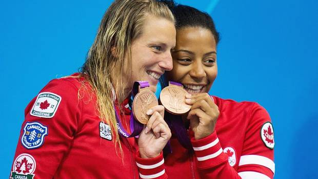 Canada's Emilie Heymans and Jennifer Abel celebrate their bronze medals for the women's synchronized three-metre springboard at the 2012 Summer Olympics in London.