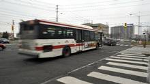A TTC bus cross the corner of Warden and Sheppard Ave East in Scarborough, Dec. 11, 2010. (J.P. Moczulski for The Globe and Mail/J.P. Moczulski for The Globe and Mail)
