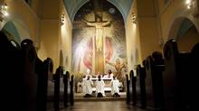 Worshippers attend mass the evening before Good Friday at St. Francis of Assisi Church in Toronto's Little Italy. (Della Rollins For The Globe and Mail)