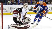 Arizona Coyotes' goalie Mike Smith makes a save on Edmonton Oilers' Leon Draisaitl during second period NHL action in Edmonton on Saturday, March 12, 2016. (JASON FRANSON/THE CANADIAN PRESS)