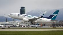A Westjet flight takes off at the Vancouver airport. (Jeff Vinnick for The Globe and Mail)