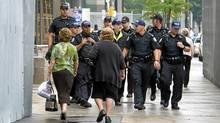 Police make their presence known Tuesday on the streets of Toronto. (Kevin Van Paassen/Kevin Van Paassen/The Globe and Mail)