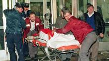 A victim is wheeled away from Montreal's Ecole Polytechnique after gunman Marc Lepine opened fire on Dec. 6, 1989 (SHANEY KOMULAINEN/Shaney Komulainen/The Canadian Press)