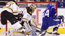 Maple Leafs defenceman Morgan Rielly scores on Boston Bruins goalie Tuukka Rask during the first period in Toronto on Monday. (Frank Gunn/THE CANADIAN PRESS)