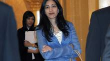 Huma Abedin, an aide to U.S. Secretary of State Hillary Clinton, heads to a meeting at the Emirates Palace Hotel in Abu Dhabi June 9, 2011. (Susan Walsh/REUTERS)