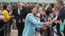 Premier Christy Clark makes her way into a ceremony with Rich Coleman in tow who was named Natural Gas Minister and Deputy Premier in Vancouver June 7, 2013 (John Lehmann/The Globe and Mail)