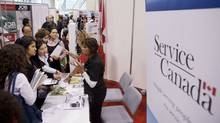 Job seekers speak with personnel at the Service Canada kiosk during the 19th edition of the National Job Fair and Training Expo at the Metro Toronto Convention Centre on Tuesday, September 27, 2011. (For The Globe and Mail)