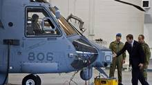 Peter MacKay inspects a new Canadian military Sikorsky CH-148 Cyclone helicopter at 12 Wing Shearwater in Halifax on Thursday May 26, 2011. (Andrew Vaughan/The Canadian Press)