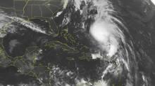 This NOAA satellite image taken Tuesday, Oct. 16, 2012 at 1:45 a.m. EDT shows Hurricane Rafael moving northward between Bermuda and Hispaniola. (Weather Underground/AP)