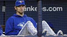 Toronto Blue Jays starting pitcher Josh Johnson looks on from the dugout during the first inning of their MLB American League baseball game against the New York Yankees at Yankee Stadium in New York, April 26, 2013. (ADAM HUNGER/REUTERS)