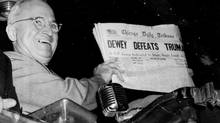 President Harry Truman holds an edition of the Chicago Daily Tribune, which, based on early results, mistakenly announced 'Dewey Defeats Truman' on Nov. 4, 1948. (BYRON ROLLINS/AP)