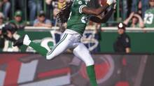Saskatchewan Roughriders wide receiver Taj Smith grabs a pass and runs in a touch down against the Winnipeg Blue Bombers during the 4th quarter of CFL action in Regina, Sask., Sunday, August 31, 2014. (Liam Richards/THE CANADIAN PRESS)