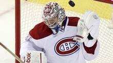 Montreal Canadiens' goalie Carey Price makes a save against Ottawa Senators during third period NHL hockey action in Montreal, March 14, 2012. (CHRISTINNE MUSCHI/Reuters)