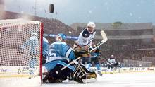 Thomas Vanek of the Buffalo Sabres and goalie Ty Conklin of the Pittsburgh Penguins matched wits during an outdoor game at Ralph Wilson Stadium in Orchard Park, N.Y., on Jan. 1, 2008. (Dave Sandford/2008 Getty Images)