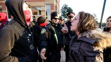 A protester of religious accommodations in Peel Region schools who was barred entry to the Peel District School Board meeting April 12 in Mississauga, shouts at a group called Brampton Against Fascism. (Glenn Lowson For The Globe and Mail)