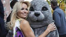 Actress Pamela Anderson takes part in a PETA protest of the Canadian seal hunt at Queen's Park in Toronto on Oct. 23, 2009. (MARK BLINCH/REUTERS)