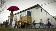 Students from Hazelwood School in Surrey run around the school portables during a break from class February 09, 2012. (John Lehmann/The Globe and Mail/John Lehmann/The Globe and Mail)