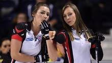 Ontario Skip Rachel Homan talks with third Emma Miskew as they take on Manitoba during the Scotties Tournament of Hearts in St. Catharines, Ont., on Thursday, Feb. 23, 2017. (Sean Kilpatrick/THE CANADIAN PRESS)