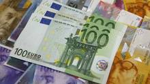 Euro banknotes lay on top of various other currencies in this file photo. (Kacper Pempel/Reuters)