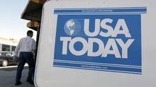 In this Sept. 29, 2009 file photo, a USA Today newspaper box is shown outside a restaurant in Charlotte, N.C. (Chuck Burton/AP)