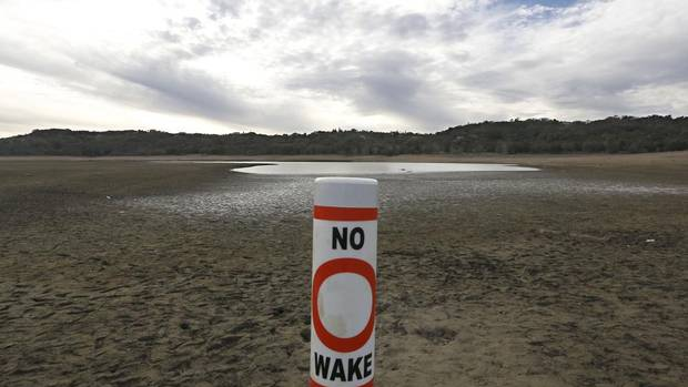 In this photo taken Tuesday, Feb. 4, 2014, a warning buoy sits on the dry, cracked bed of Lake Mendocino near Ukiah, Calif. Despite recent spot rains, the reservoir, located in Mendocino County, is currently only about 37 percent full. California remains in the midst of a historic drought, prompting Gov. Jerry Brown to declare a state of emergency. (Rich Pedroncelli/AP)