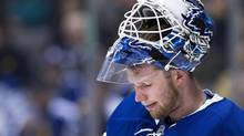 Toronto Maple Leafs goalie James Reimer (34) looks on during stoppage in play against the Winnipeg Jets during first period NHL action in Toronto on Saturday, April 5, 2014. (Nathan Denette/THE CANADIAN PRESS)