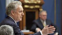 Quebec Premier Jean Charest responds to Opposition questions on the conflict with students over tuition hikes on May 2, 2012, at the legislature in Quebec City. (Jacques Boissinot/Jacques Boissinot / The Canadian Press)