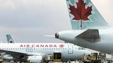 Air Canada planes are pictured at Toronto's Pearson International Airport on May 18, 2014. Air Canada is apologizing to a Prince Edward Island family after the airline bumped a 10-year-old boy from a flight. (Matthew Sherwood For The Globe and Mail)