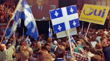 A crowd of Yes supporters wave Quebec flags at a Montreal rally during a live television address by Prime Minister Jean Chretien on Oct. 25, 1995. (Paul Chiasson/The Canadian Press)