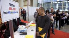 Job seekers wait in line to speak with a representative of Toronto Pathways during the 19th edition of the National Job Fair and Training Expo at the Metro Toronto Convention Centre on Tuesday, September 27, 2011. (Matthew Sherwood For The Globe and Mail)
