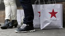 Macy's Inc. cut its full-year same-store sales forecast August 13, 2014, after second-quarter sales failed to make up for weakness in the first quarter when harsh weather kept shoppers away. (BRENDAN MCDERMID/REUTERS)