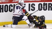 Canada's Caroline Ouellette crashes into Julie Chu of the U.S. during the first period of their preliminary round game at the IIHF Ice Hockey Women's World Championship in Ottawa April 2, 2013. (Reuters)