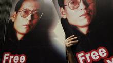 Pro-democracy activists display a poster of Chinese dissident Liu Xiaobo, who was arrested a year ago after co-authoring a manifesto urging civil rights and political reforms in China. Kin Cheung/AP (Kin Cheung)