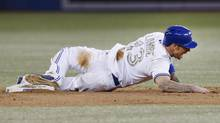Toronto Blue Jays' Brett Lawrie injures himself sliding into second base on a steal against the Atlanta Braves during the sixth inning. (MARK BLINCH/REUTERS)