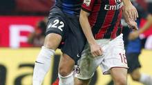 Inter Milan's Diego Milito and AC Milan's Riccardo Montolivo fight for the ball during their Italian Serie A soccer match at San Siro stadium in Milan October 7, 2012. (STEFANO RELLANDINI/REUTERS)