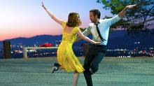 """Emma Stone and Ryan Gosling are shown in a scene from the film """"La La Land."""" Fans at the Toronto International Film Festival have give the nod to director Damien Chazelle's """"La La Land"""" in the annual People's Choice Award. (Dale Robinette/THE CANADIAN PRESS)"""
