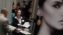Tanya Faiman meets with a job recruiter from a jewellery and gem company during the Gemological Institute Of America (GIA)'s Jewelry Career Fair in New York in this file photo. (SHANNON STAPLETON/REUTERS)