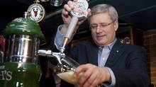 Prime Minister Stephen Harper pours pints of beer at the Red Stag tavern during a campaign stop in Halifax, Thursday March 31, 2011. (Adrian Wyld/The Canadian Press/Adrian Wyld/The Canadian Press)