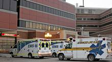 EDMONTON AB: JANUARY 12, 2012. Ambulances wait outside the emergency entrance at the University of Alberta Hospital in Edmonton. (Jason Franson for The Globe and Mail)