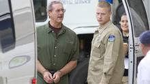 Allen Stanford, left, enters federal court in Houston on Tuesday to hear the verdict in his criminal trial. (Richard Carson/Reuters/Richard Carson/Reuters)