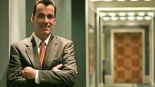 David Brennan of the U.S. poses at the London headquarters of the British pharmaceutical company AstraZeneca after his appointment as chief executive designate, October 31, 2005. (MIKE FINN-KELCEY/REUTERS)