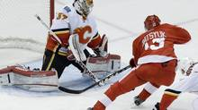 Calgary Flames goalie Leland Irving (37) stops a shot by Detroit Red Wings center Pavel Datsyuk (13) during the third period of an NHL hockey game in Detroit, Tuesday, Feb. 5, 2013. (Paul Sancya/AP)