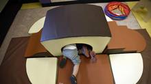 Toddlers play in soft-play structures in the Infant Room at the Sir Samuel B. Steele YMCA in this June 2014 file photo. (Fred Lum/The Globe and Mail)