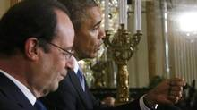 U.S. President Barack Obama and French President Francois Hollande address a joint news conference in the East Room of the White House in Washington, February 11, 2014. (JONATHAN ERNST/REUTERS)