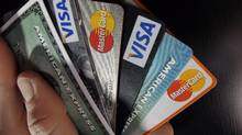Consumer credit cards are shown in North Andover, Mass., Match 5, 2012. (Elise Amendola/AP)