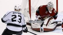 The Arizona Coyotes' Louis Domingue makes a save on a shot by the Los Angeles Kings' Dustin Brown during an NHL hockey game on Saturday, Jan. 23, 2016, in Glendale, Ariz. (Ross D. Franklin/AP)